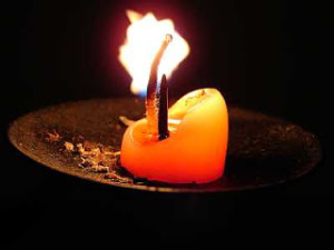 Candle_stump_on_holder_Wikimedia_Commons